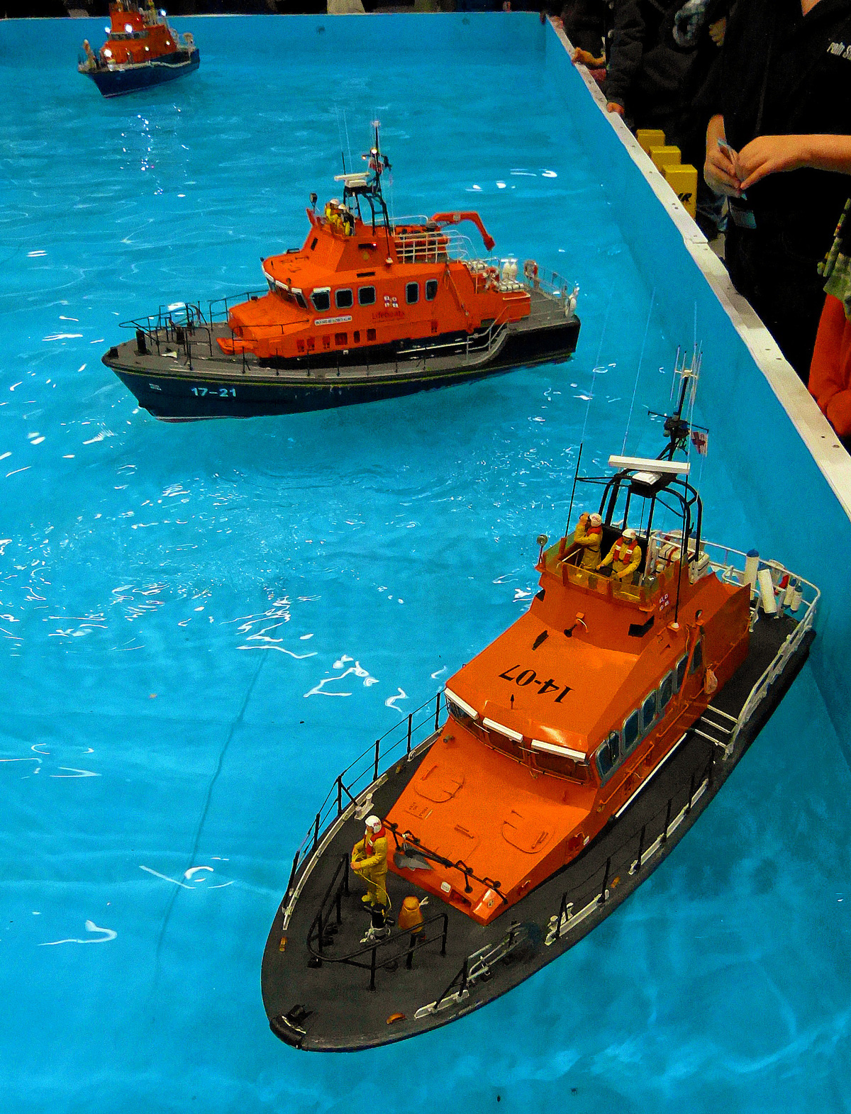 Model RNLI boats on the pool